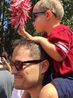 Seth Bordner with a young child on his shoulders