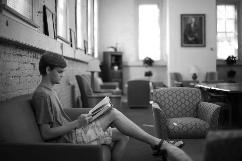 a student reads in the main hall of a Blount program academic house