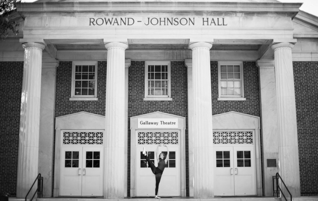 a Blount program student who is also a dancer poses in front of Rowand-Johnson Hall, home of the university's dance department