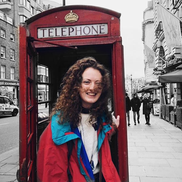 A Picture of a Blount Student in front of a London Telephone booth